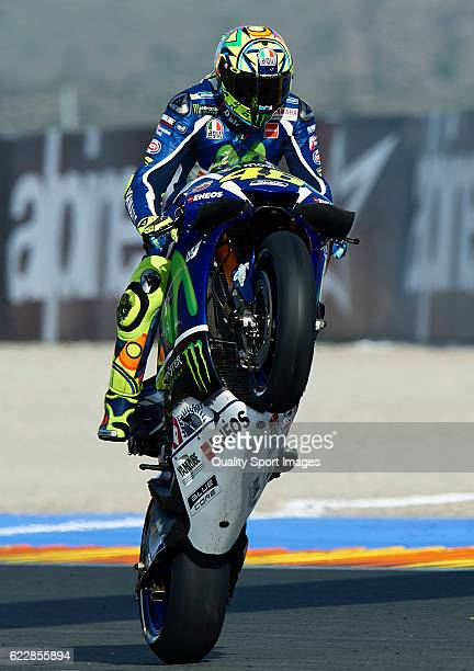 Valentino Rossi of Italy and Movistar Yamaha MotoGP lifts the front wheel during the MotoGP of Valencia Qualifying at Comunitat Valenciana Ricardo...