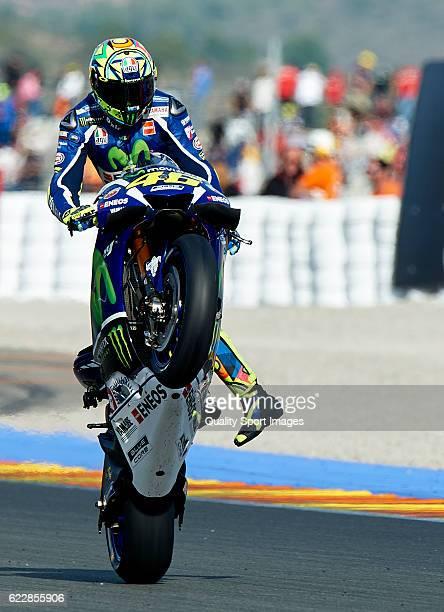 Valentino Rossi of Italy and Movistar Yamaha MotoGP lifts the front wheel during the MotoGP of Valencia Qualifying at Comunitat Valenciana Ricardo...