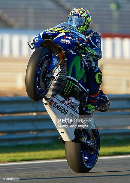 Valentino Rossi of Italy and Movistar Yamaha MotoGP lifts the front wheel during the MotoGP Test in Valencia at Ricardo Tormo Circuit on November 16...