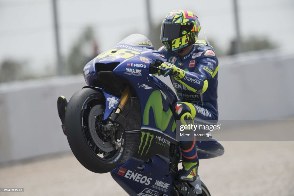 Valentino Rossi of Italy and Movistar Yamaha MotoGP lifts the front wheel during the MotoGp of Catalunya - Free Practice at Circuit de Catalunya on June 9, 2017 in Montmelo, Spain.