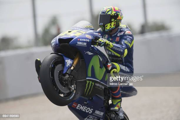 Valentino Rossi of Italy and Movistar Yamaha MotoGP lifts the front wheel during the MotoGp of Catalunya Free Practice at Circuit de Catalunya on...