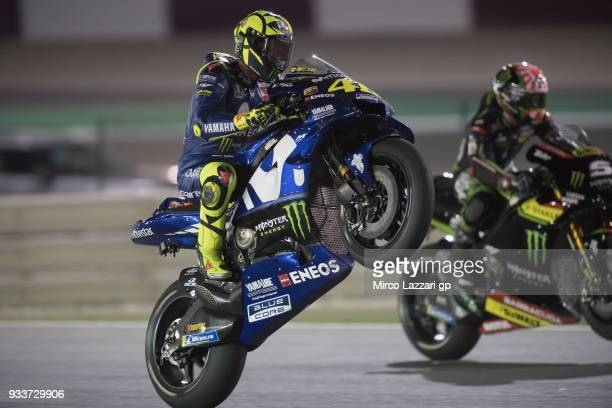 Valentino Rossi of Italy and Movistar Yamaha MotoGP lifts the front wheel and celebrates the third place at the end of the MotoGP race during the...