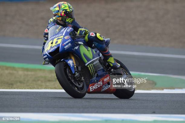 Valentino Rossi of Italy and Movistar Yamaha MotoGP lloks back and heads down a straight during the MotoGp of Spain Free Practice at Circuito de...