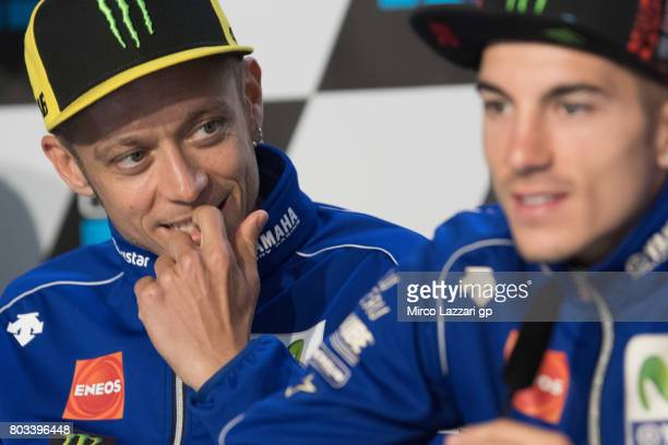 Valentino Rossi of Italy and Movistar Yamaha MotoGP looks Maverick Vinales of Spain and Movistar Yamaha MotoGP during the press conference during the...