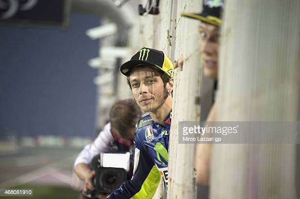 Valentino Rossi of Italy and Movistar Yamaha MotoGP looks on the start of the Moto3 race during the MotoGp of Qatar Race at Losail Circuit on March...
