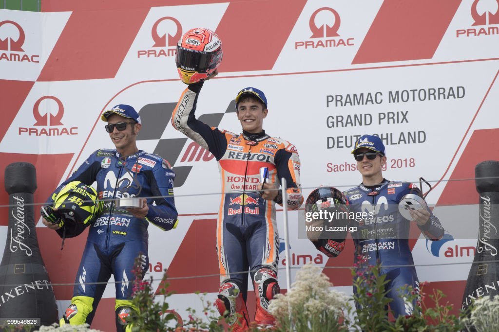 Valentino Rossi of Italy and Movistar Yamaha MotoGP, Marc Marquez of Spain and Repsol Honda Team and Maverick Vinales of Spain and Movistar Yamaha MotoGP celebrate on the podium at the end of the MotoGP race during the MotoGp of Germany - Race at Sachsenring Circuit on July 15, 2018 in Hohenstein-Ernstthal, Germany.
