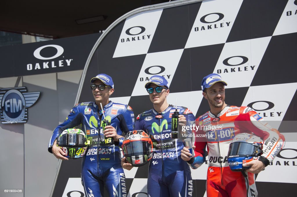 Valentino Rossi of Italy and Movistar Yamaha MotoGP, Maverick Vinales of Spain and Movistar Yamaha MotoGP and Andrea Dovizioso of Italy and Ducati Team pose during the MotoGp of Italy - Qualifying at Mugello Circuit on June 3, 2017 in Scarperia, Italy.