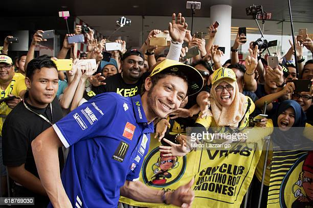 Valentino Rossi of Italy and Movistar Yamaha MotoGP poses for fans during the autograph session during the MotoGP Of Malaysia - Free Practice at...