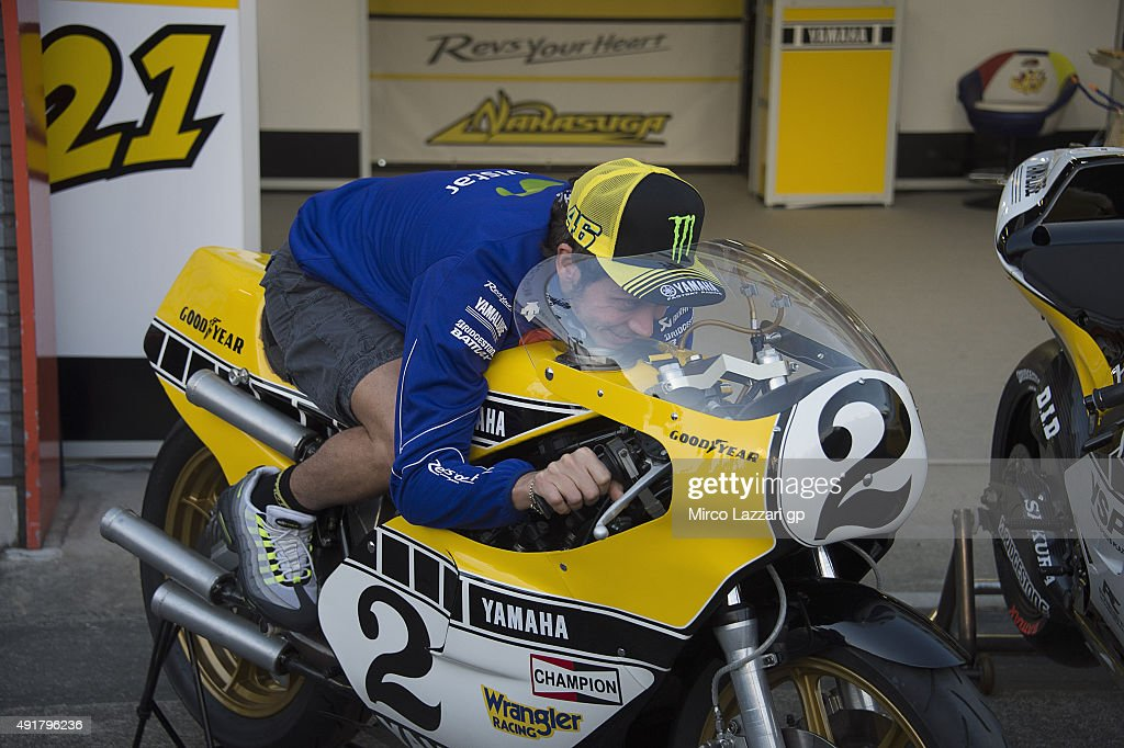 Valentino Rossi of Italy and Movistar Yamaha MotoGP poses with the Yamaha 750 of Kenny Roberts' bike during the MotoGP Of Japan - Previews at Twin Ring Motegi on October 8, 2015 in Motegi, Japan.