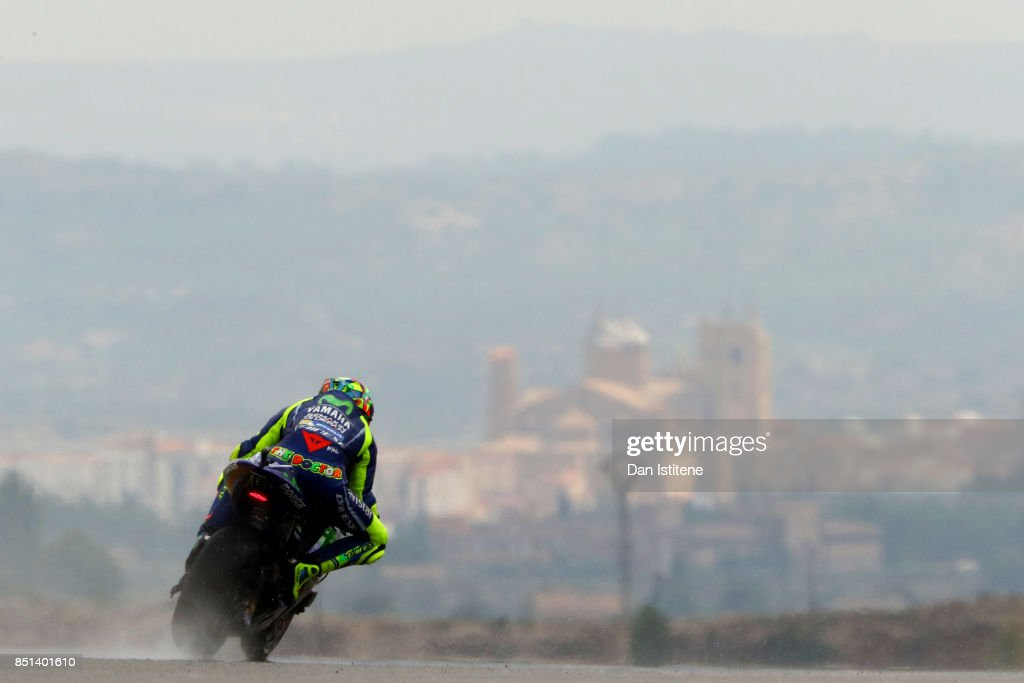 Valentino Rossi of Italy and Movistar Yamaha MotoGP rides backdropped by the Santa Maria la Mayor church in the nearby town of Alcaniz, during practice for the MotoGP of Aragon at Motorland Aragon Circuit on September 22, 2017 in Alcaniz, Spain.