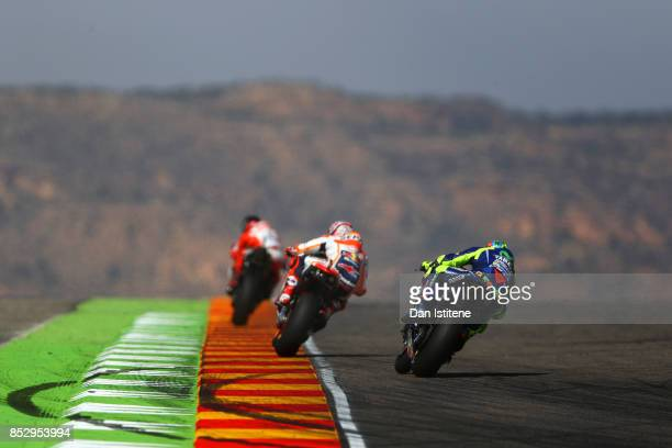 Valentino Rossi of Italy and Movistar Yamaha MotoGP rides behind Marc Marquez of Spain and the Repsol Honda Team and Jorge Lorenzo of Spain and the...