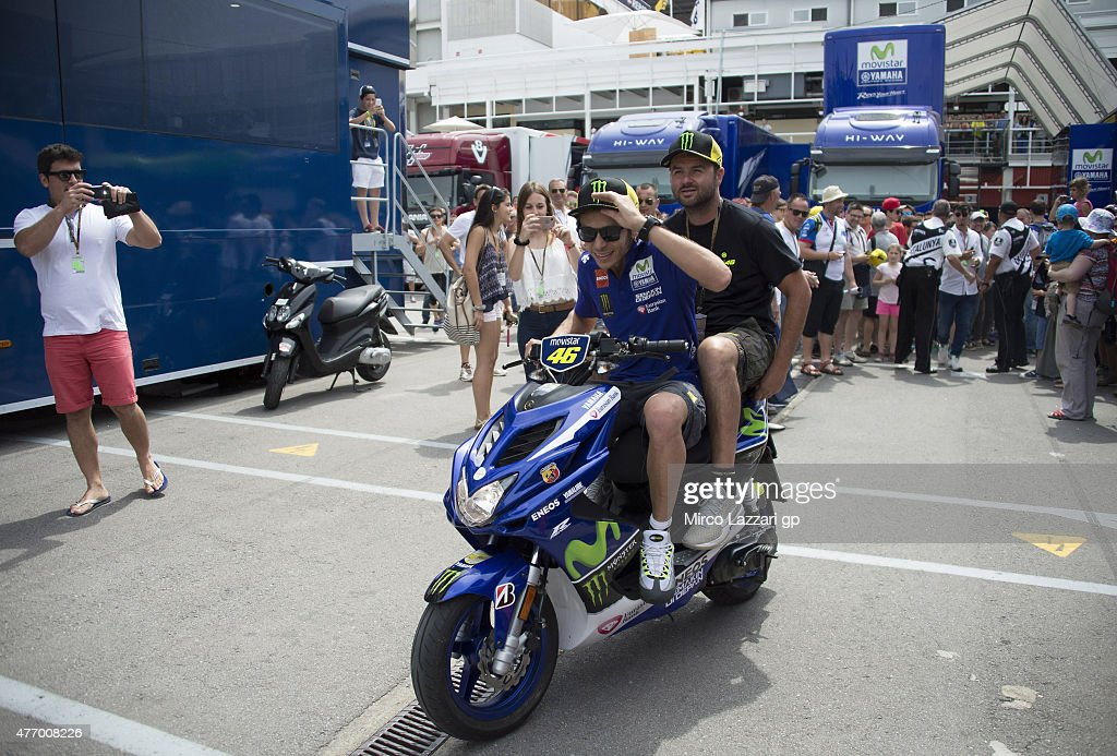 Valentino Rossi of Italy and Movistar Yamaha MotoGP rides the scooter and greets the fans in paddock during the MotoGp of Catalunya - Qualifying at Circuit de Catalunya on June 13, 2015 in Montmelo, Spain.