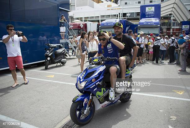 Valentino Rossi of Italy and Movistar Yamaha MotoGP rides the scooter and greets the fans in paddock during the MotoGp of Catalunya Qualifying at...