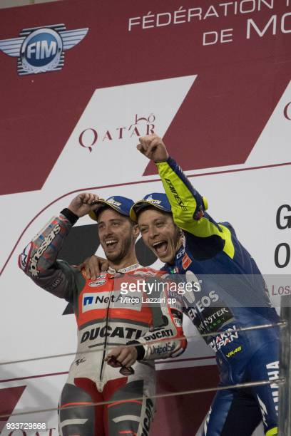Valentino Rossi of Italy and Movistar Yamaha MotoGP smile with Andrea Dovizioso of Italy and Ducati Team on the podium at the end of the MotoGP race...