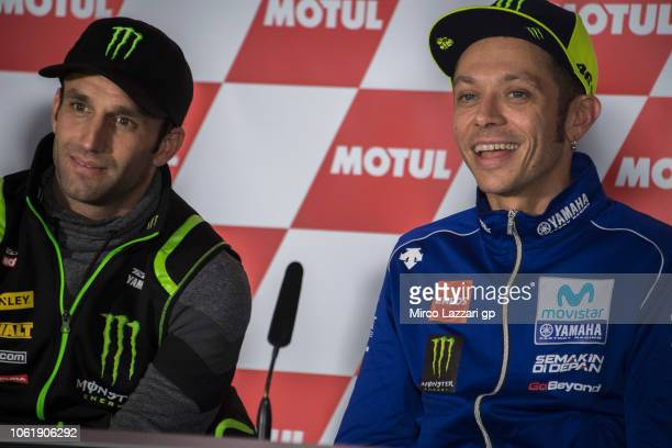 Valentino Rossi of Italy and Movistar Yamaha MotoGP smiles and Johann Zarco of France and Monster Yamaha Tech 3 looks on during the press conference...