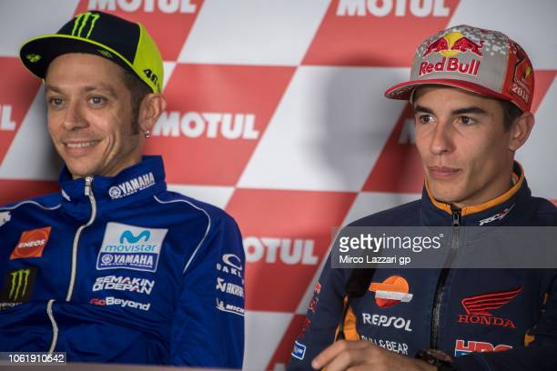 Valentino Rossi of Italy and Movistar Yamaha MotoGP smiles and Marc Marquez of Spain and Repsol Honda Team looks on during the press conference...