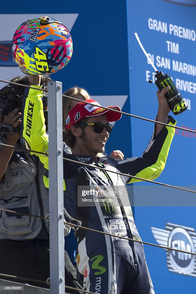 Valentino Rossi of Italy and Movistar Yamaha MotoGP smiles and celebrates the victory on the podium at the end of the MotoGP race during the MotoGP of San Marino - Race at Misano World Circuit on September 14, 2014 in Misano Adriatico, Italy.