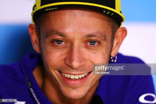 Valentino Rossi of Italy and Movistar Yamaha MotoGP smiles during a press conference during previews for the MotoGP of Aragon at Motorland Aragon...