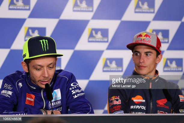 Valentino Rossi of Italy and Movistar Yamaha MotoGP speaks and Marc Marquez of Spain and Repsol Honda Team looks on during the press conference...