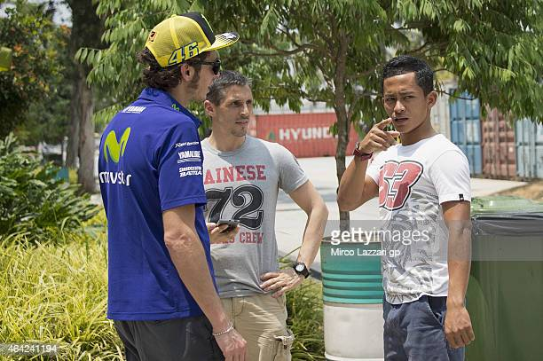 Valentino Rossi of Italy and Movistar Yamaha MotoGP speaks in paddock with Zulfahmi Khairuddin of Malaysia during the MotoGP Tests in Sepang Day One...
