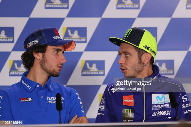 Valentino Rossi of Italy and Movistar Yamaha MotoGP speaks with Alex Rins of Spain and Team Suzuki ECSTAR during the press conference during the...