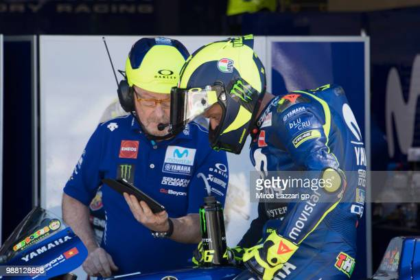 Valentino Rossi of Italy and Movistar Yamaha MotoGP speaks with mechanic in box during the Qualifying practice during the MotoGP Netherlands...