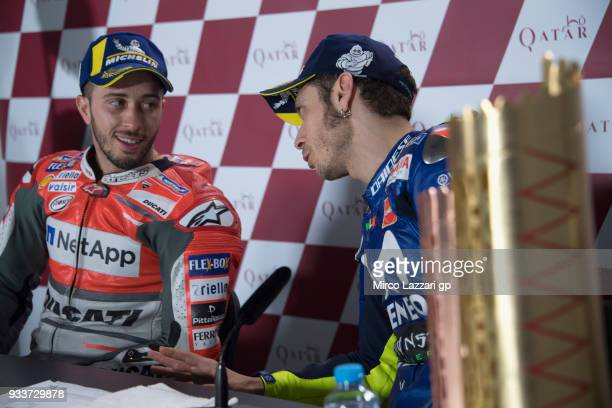 Valentino Rossi of Italy and Movistar Yamaha MotoGP speaks with Andrea Dovizioso of Italy and Ducati Team during the press conference at the end of...