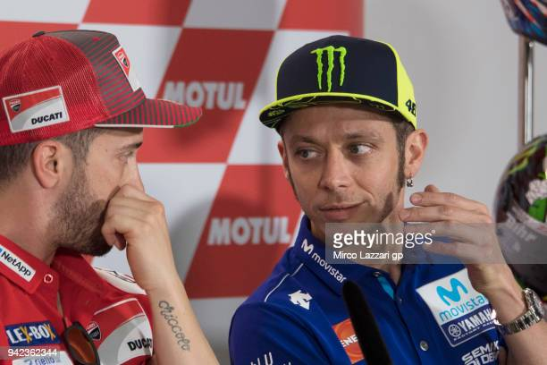 Valentino Rossi of Italy and Movistar Yamaha MotoGP speaks with Andrea Dovizioso of Italy and Ducati Team during the press conference preevent during...