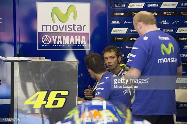 Valentino Rossi of Italy and Movistar Yamaha MotoGP speaks with mechanics during the Michelin tires test during the MotoGp Tests At Mugello at...