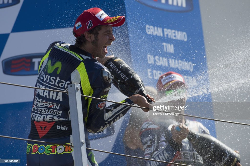 Valentino Rossi of Italy and Movistar Yamaha MotoGP sprays champagne and celebrates the victory on the podium at the end of the MotoGP race during the MotoGP of San Marino - Race at Misano World Circuit on September 14, 2014 in Misano Adriatico, Italy.