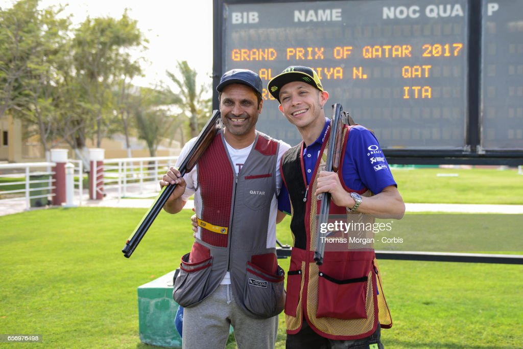 Valentino Rossi of Italy and Movistar Yamaha MotoGP takes part in a shooting lesson with Nasser Al-Attiyah, London 2012 Men's Skeet Olympic Bronze Medalist in and former Dakar Rally winner, at Losail Shooting Club ahead of the MotoGp of Qatar on March 22, 2017 in Doha, Qatar.