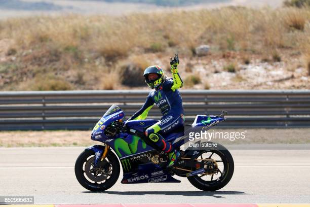 Valentino Rossi of Italy and Movistar Yamaha MotoGP waves to the fans after the MotoGP of Aragon at Motorland Aragon Circuit on September 24 2017 in...