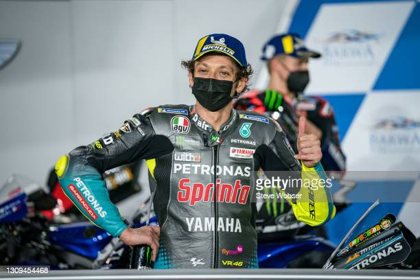 Valentino Rossi of Italy and Petronas Yamaha SRT shows thumbs up after his best independent rider position at parc ferme during qualifying session at...