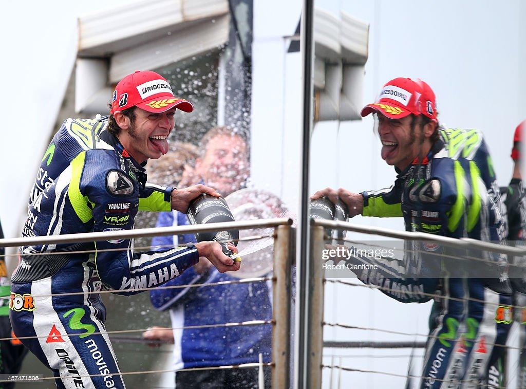 Valentino Rossi of Italy and rider of the #46 Movistar Yamaha MotoGp Yamaha celebrates on the podium after winning the 2014 MotoGP of Australia at Phillip Island Grand Prix Circuit on October 19, 2014 in Phillip Island, Australia.