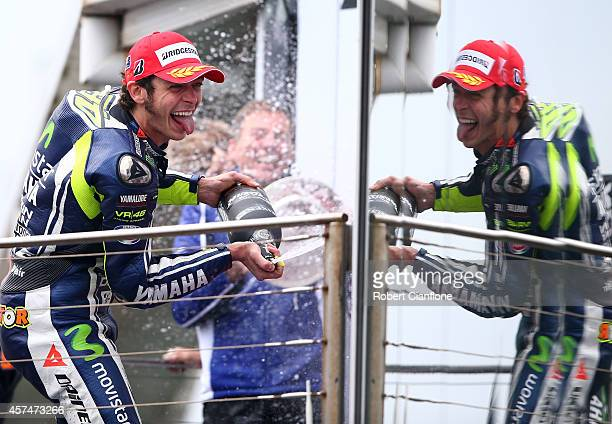 Valentino Rossi of Italy and rider of the Movistar Yamaha MotoGp Yamaha celebrates on the podium after winning the 2014 MotoGP of Australia at...