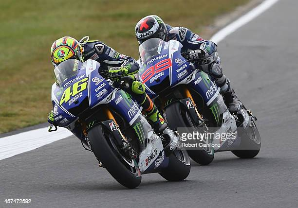 Valentino Rossi of Italy and riding the Movistar Yamaha MotoGp Yamaha leads Jorge Lorenzo of Spain riding the Movistar Yamaha MotoGp Yamaha during...