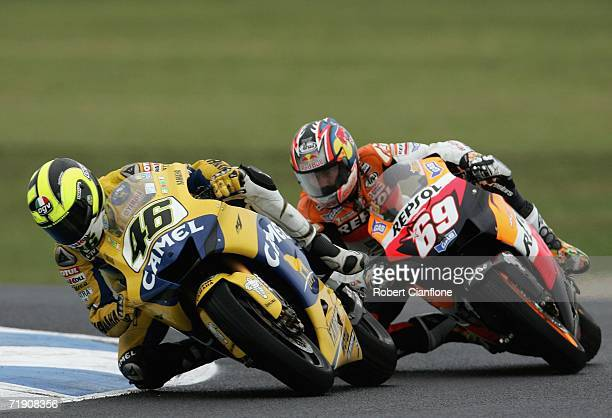Valentino Rossi of Italy and the Camel Yamaha Team is followed by Nicky Hayden of the USA and the Repsol Honda Team during the Australian Motorcycle...