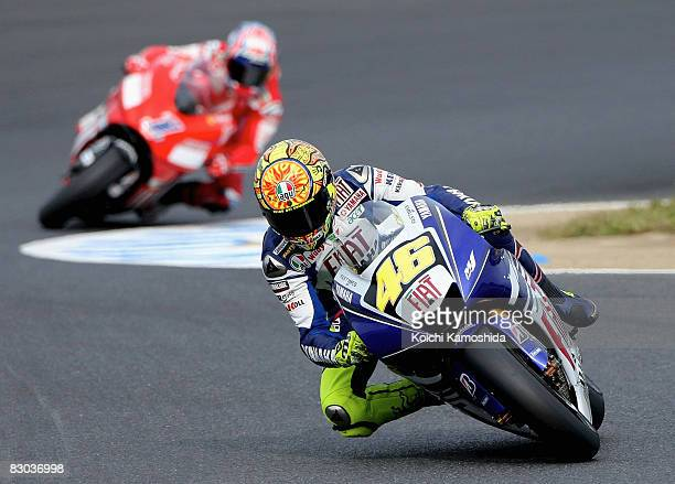 Valentino Rossi of Italy and the Fiat Yamaha Team leads Casey Stoner of Australia and the Ducati Marlboro Team during the MotoGP World Championship...