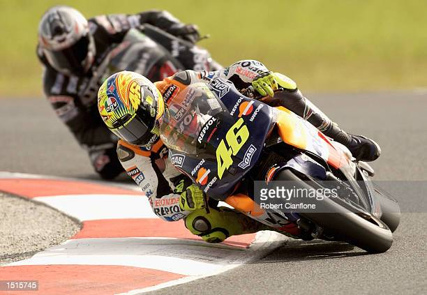 Valentino Rossi of Italy and the Repsol Honda Team leads Alex Barros of Brazil and the West Honda Pons Team during the Skyy Vodka Australian Grand...