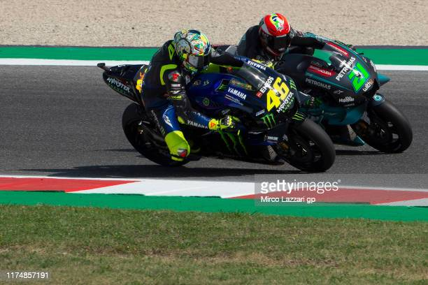 Valentino Rossi of Italy and Yamaha Factory Racing and Franco Morbidelli of Italy and Petronas Yamaha SRT round the bend during the MotoGP race...