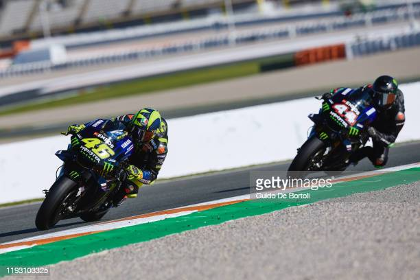 Valentino Rossi of Italy and Yamaha Factory Racing and Lewis Hamilton of Great Britain and AMG Petronas F1 Team Mercedes riding the 2019 Yamaha...