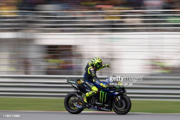 Valentino Rossi of Italy and Yamaha Factory Racing greets the fans during the MotoGP race during the MotoGP of Malaysia - Race at Sepang Circuit on...