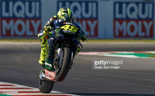 Valentino Rossi of Italy and Yamaha Factory Racing lifts the front wheel during free practice for the MotoGP of San Marino at Misano World Circuit on...