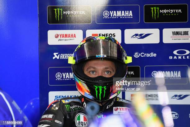 Valentino Rossi of Italy and Yamaha Factory Racing looks on in box during the pre-season MotoGP Tests in Valencia at Ricardo Tormo Circuit on...