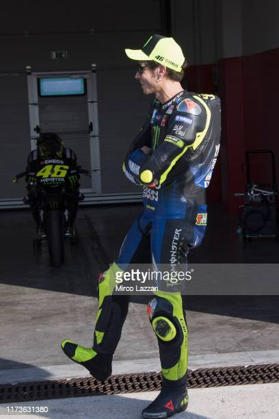 """Valentino Rossi of Italy and Yamaha Factory Racing looks on the bike in box in Misano Circuit during the event """"Valentino Rossi Filming In Tavullia""""..."""