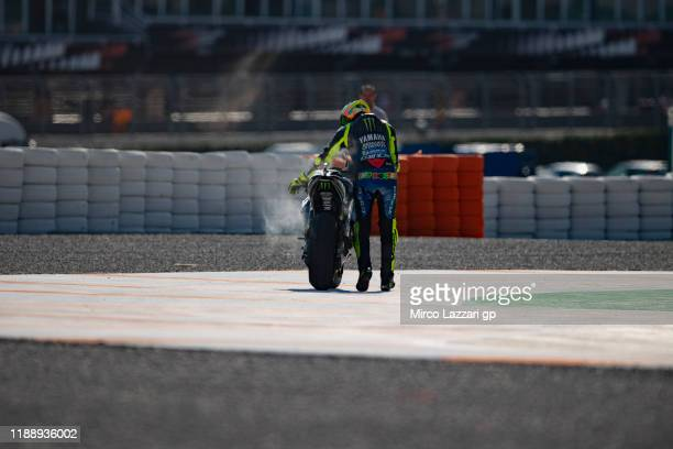 Valentino Rossi of Italy and Yamaha Factory Racing push the bike out of track during the MotoGP Tests in Valencia at Ricardo Tormo Circuit on...