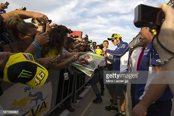 Valentino Rossi of Italy and Yamaha Factory Racing signs autographs for fans during the pit walk during the MotoGP of Valencia Previews at Ricardo...
