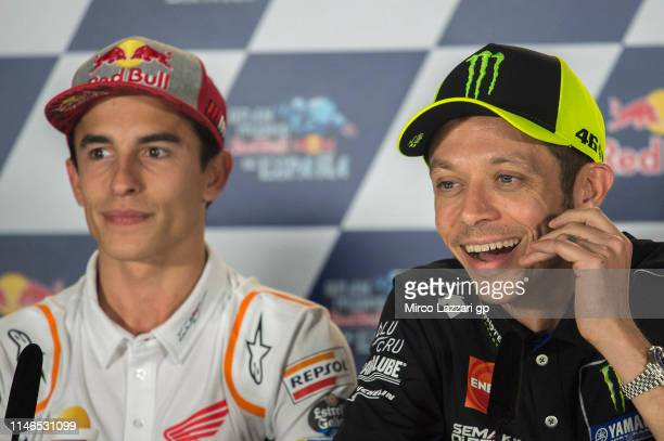 Valentino Rossi of Italy and Yamaha Factory Racing speaks and Marc Marquez of Spain and Repsol Honda Team looks on during a press conference prior to...