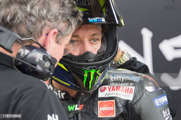 Valentino Rossi of Italy and Yamaha Factory Racing speaks with mechanic in box during the MotoGP of Japan - Qualifying at Twin Ring Motegi on October...