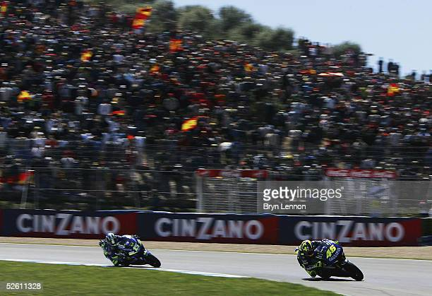 Valentino Rossi of Italy and Yamaha leads Sete Gibernau of Spain and Honda during the Spanish MotoGP at the Circuito de Jerez on April 10, 2005 in...